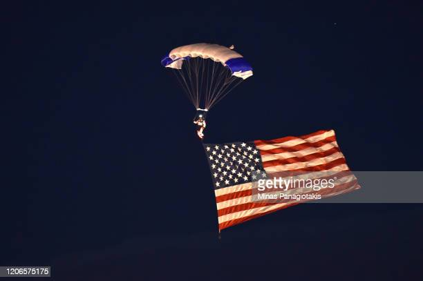 The Wings of Blue parachute team descends into Falcon Stadium during the singing of the National Anthem prior to the 2020 NHL Stadium Series between...