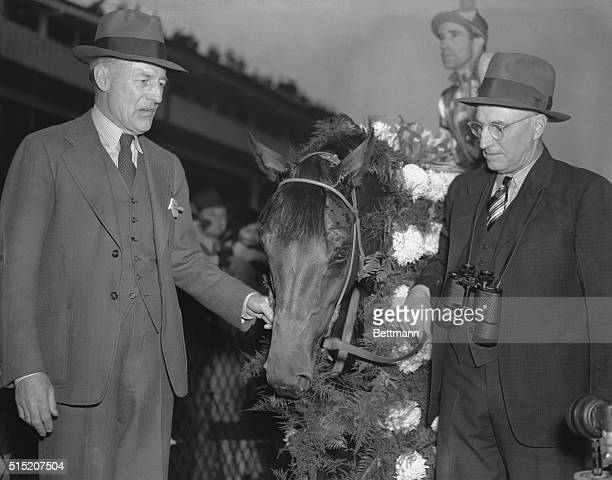 The 'Winnah and New Champeen' Pimlico Track Maryland Owner CS Howard left trainer T Smith right and the great 'Seabiscuit' are pictured at Pimlico...