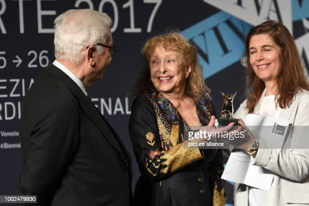 The winner for the Golden Lion for her life's work is the US artist Carolee Schneemann stands on stage during the award ceremony of the 57th Biennale...