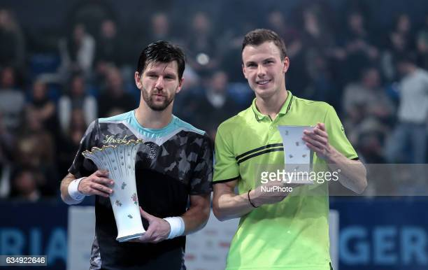 The winner is Jurgen Melzer of Austria and the runner up is Marton Fucsovics of Hungary pose at the award ceremony at Hungarian Challenger Open 2017...