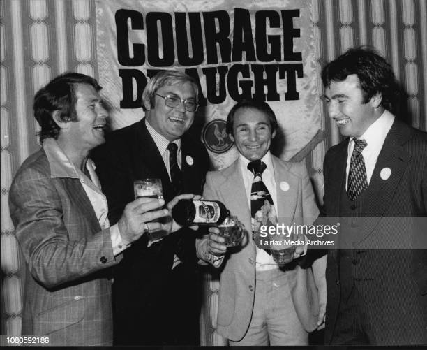 """The winner Mark Shulman gets an congratulatory glass of Courage beer from John O""""Shea 2nd from left, and past winners Billy Smith and Max Krilich..."""