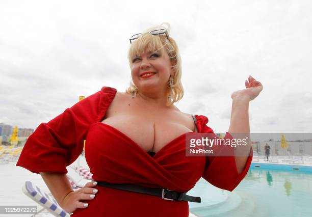 The winner Mila Kuznetsova with 13th breast size poses during the Ukrainian record in a nomination 'The largest female natural breasts' in Kyiv,...