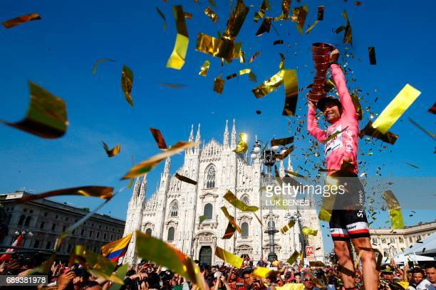 TOPSHOT The winner of the 100th Giro d'Italia Tour of Italy cycling race Netherlands' Tom Dumoulin of team Sunweb holds the trophy on the podium near...