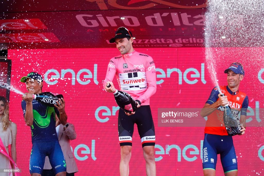The winner of the 100th Giro d'Italia, Tour of Italy cycling race, Netherlands' Tom Dumoulin (C) of team Sunweb celebrates on the podium with Italy's rider of team Bahrain - Merida Vincenzo Nibali (R), third, and Colombia's Nairo Quintana of team Movistar, second, after the last stage, an individual time-trial between Monza and Milan, on May 28, 2017. / AFP PHOTO / Luk BENIES