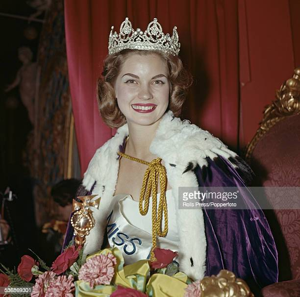 The winner of the 1958 Miss World beauty contest Penelope Coelen of South Africa is pictured sitting on a throne and wearing the winner's crown at...