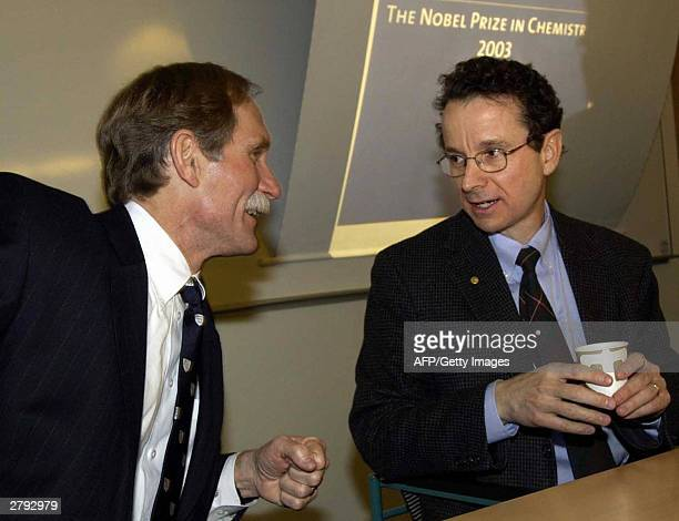 The winner of the 2003 Nobel Prize in chemistry American Peter Agre talks to fellow laureate and countryman Roderick MacKinnon while meeting the...