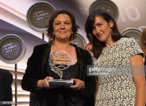 The winner of the 2014 Premio Planeta literature award Spanish writer Clara Sanchez poses with finalist Angeles GonzalezSinde during the ceremony of...