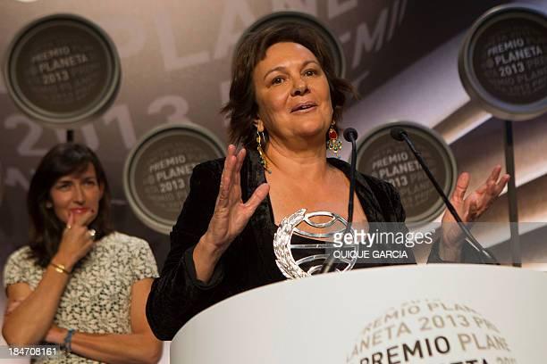The winner of the 2014 Premio Planeta literature award Spanish writer Clara Sanchez delivers a speech next to finalist Angeles GonzalezSinde during...