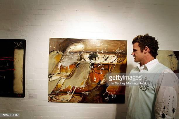 The winner of the Brett Whiteley Travelling Art Scholarship artist Wayde Owen looking at his his winning painting Californian Quail 2005 in the Brett...