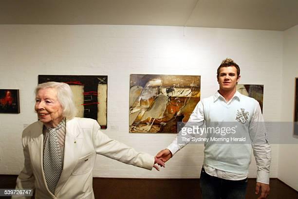 The winner of the Brett Whiteley Travelling Art Scholarship artist Wayde Owen holding hands with Brett Whiteley s mother Beryl Whiteley with his...