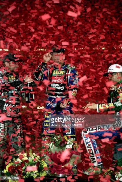 The winner of the British Grand Prix Tony Rickardsson runner up Jason Crump and third placed Tomasz Gollob are drowned in confetti