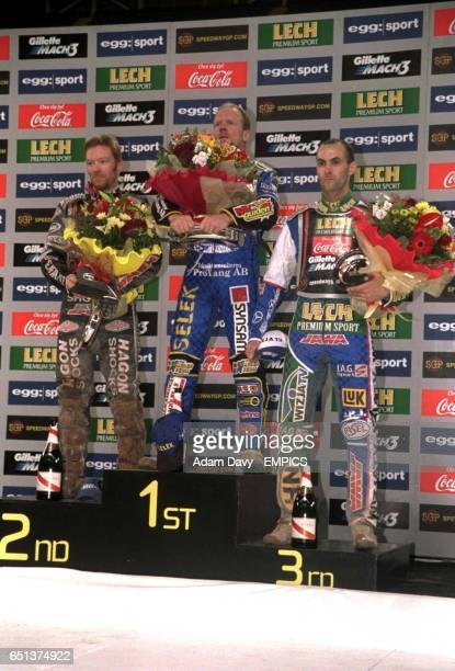 The winner of the British Grand Prix Tony Rickardsson runner up Jason Crump and third placed Tomasz Gollob celebrate their respective positions on...