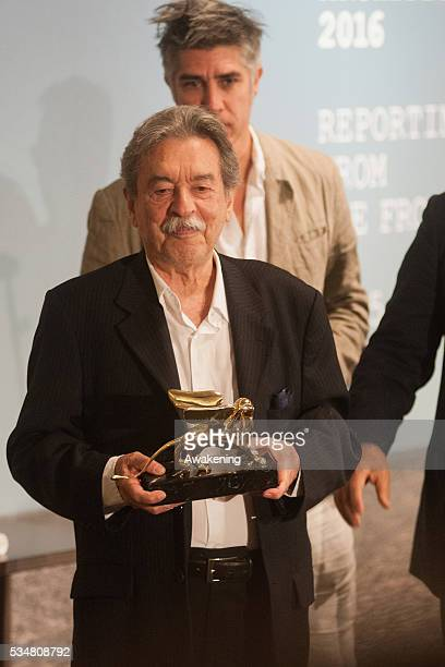 The winner of the Golden Lion for Lifetime Achievement Paulo Mendes da Rocha poses at the official opening ceremony of the 15th Biennale of...