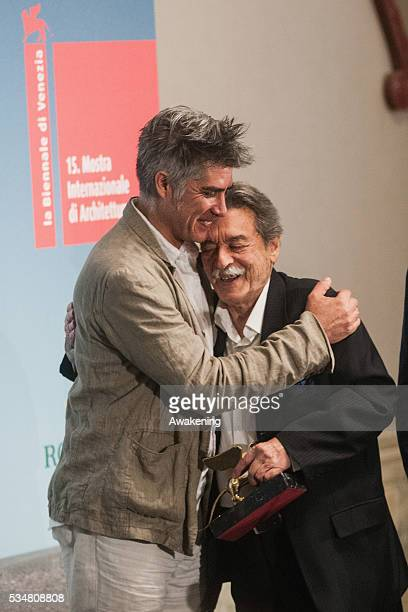 The winner of the Golden Lion for Lifetime Achievement Paulo Mendes da Rocha welcomed by Alejandro Aravena at the official opening ceremony of the...