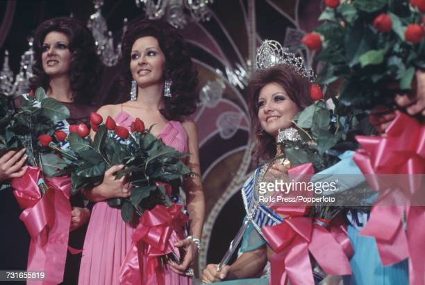 The winner of the Miss Universe 1971 beauty pagent Georgina Rizk of Lebanon is pictured wearing a crown in centre with two runners up at the Miami...