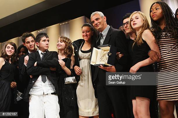 The winner of the Palme dOr director Laurent Cantet for The Class with the cast of the film during the Palme d'Or Closing Ceremony at the Palais des...