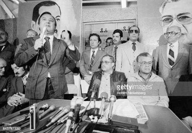 The winner of the presidential election General Angel Aníbal Guevara center seated looks on as a political party leader from the winning Popular...