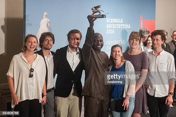 The winner of the Silver Lion for a promising young participant in NLE receives the prize at the official opening ceremony of the 15th Biennale of...