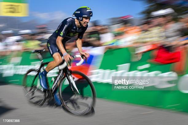 The winner of the Tour of Switzerland Portugal's Rui Costa rides on his way to win the final stage a 268 km time trial between Bad Ragaz and...