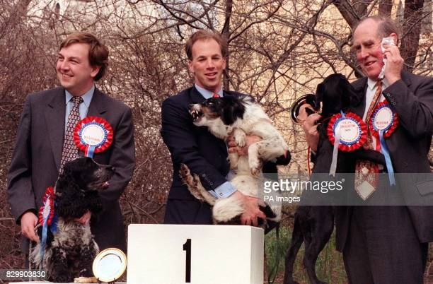 The winner of the Westminster Dog of the Year Competition is flanked by 3rd place and runnerup in London today John Whittingdale with Humphrey a Blue...