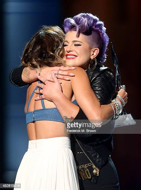 The winner of Young Hollywood Trendsetter Award Actress Vanessa Hudgens and host Kelly Osbourne onstage at the 2014 Young Hollywood Awards brought to...