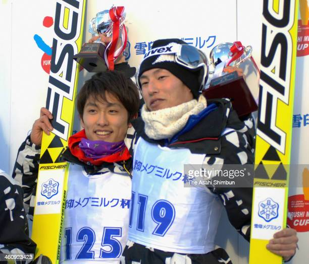 The winner Reruhi Shimizu and Daiki Ito third during the Ski Jumping Megmilk Cup on January 5 2013 in Sapporo Japan