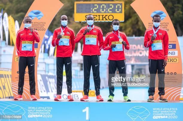 The winner team of Kenya Kibiwott Kandie Leonard Bartsoton Benard Kimeli Benard Kipkorir Ngeno and Morris Munene Gachaga celebrate on the podium...