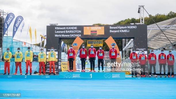 The winner team of Kenya second placed team Ethiopia and third placed team Uganda pose on the podium after the men's race of the 2020 IAAF World Half...