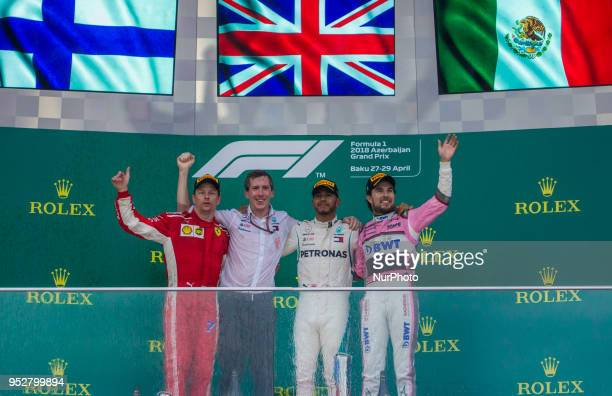 The winners 1st Lewis Hamilton, 2nd Kimi Räikkönen and 3rd Sergio Perez on the podium during the award ceremony at Azerbaijan Formula 1 Grand Prix on...