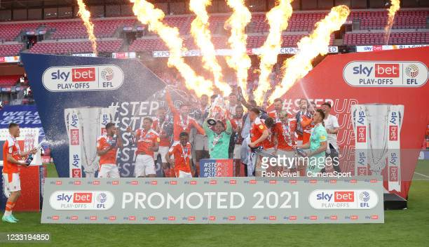 The winners Blackpool celebrate during the Sky Bet League One Play-off Final match between Blackpool and Lincoln City at Wembley Stadium on May 30,...