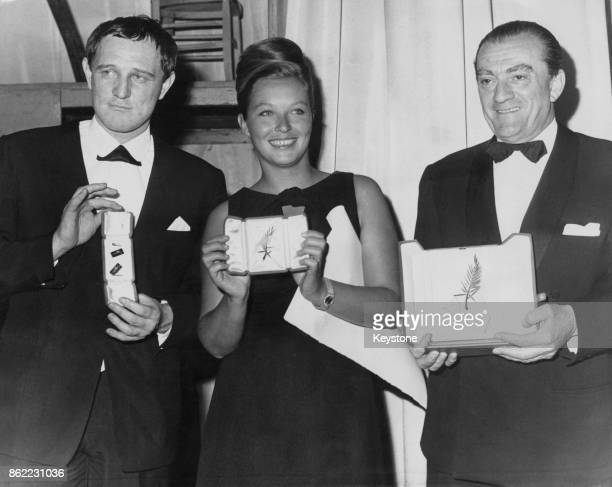 The winners collect their awards at the Cannes Film Festival in France 24th May 1963 From left to right Irish actor Richard Harris wins Best Actor...