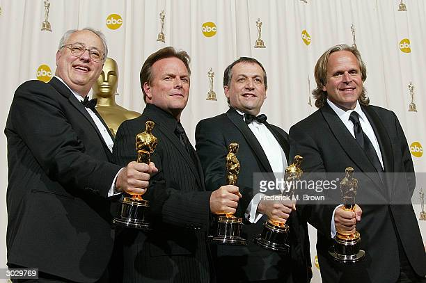 The winners for Achievement in Visual Effects for The Lord of the Rings The Return of the King pose during the 76th Annual Academy Awards at the...