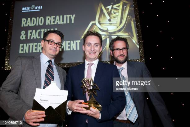 The winners in the category 'Game Show' producer John Ryan creative director James Fox and manager Nick Mather stand with their awards at the 53rd...