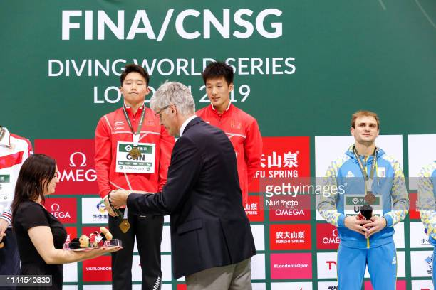 The winners Luxian WU and Zongyuan WANG of China receive their medals after the Men's 3 meter Synchronized Springboard competition during the the...