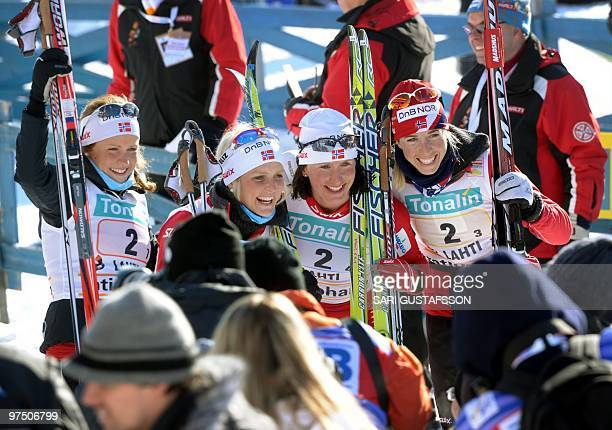 The winners of Norway Marthe Kristoffersen Therese Johaug Marit Björgen and Kristin Steira pose after carrying off the ladies' 4 x 5 km classic/free...