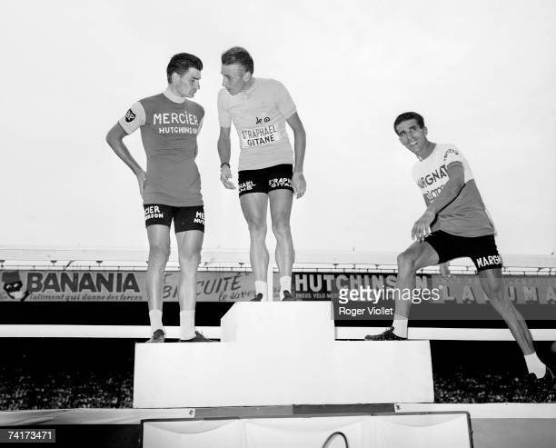 The winners of the 1964 Tour de France at Parc des Princes Paris From left to right French cyclists Raymond Poulidor Jacques Anquetil and Spanish...