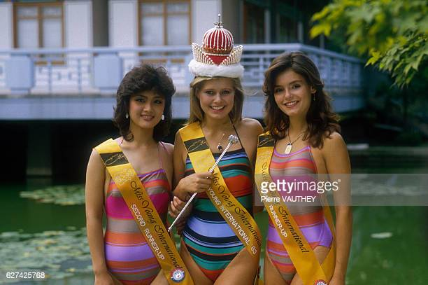 The winners of the 1983 Miss Young International beauty pageant From left are second place runnerup Sun Mi Kim of Korea winner Ana Sofie Falkenaas of...