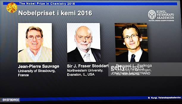 The winners of the 2016 Nobel Chemistry Prize JeanPierre Sauvage J Fraser Stoddart and Bernard L Feringa are displayed on a screen during a press...