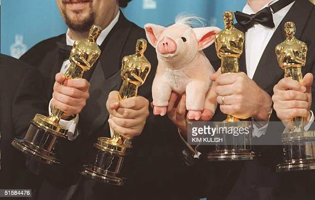 The winners of the Best Visual Effects award at the 68th annual Academy awards pose with their Oscars and a stuffed pig 25 March at the Dorothy...