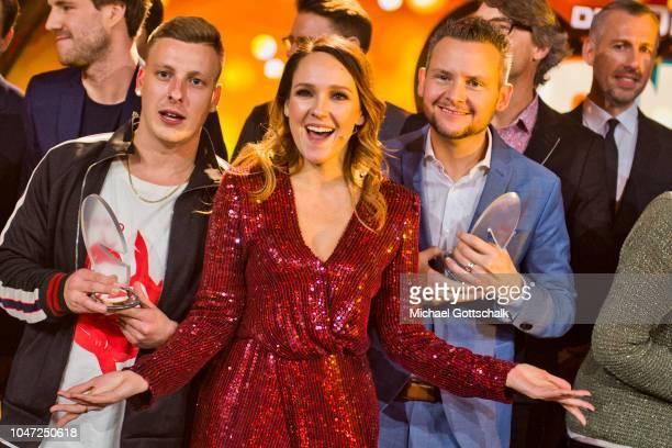 The winners of the German Comedy Award Felix Lobrecht winner of Best Newcomer Carolin Kebekus winner of Best TV Solo and Tobias Mann winner of Best...