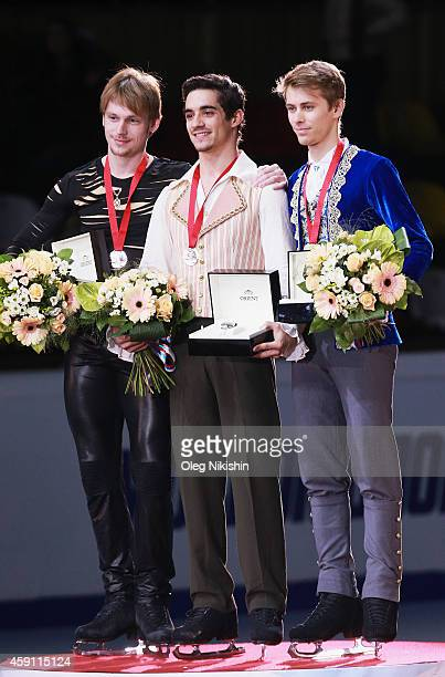 The winners of the Men competition from left to right are silver medalist from Russia Sergei Voronov gold medalist from Spain Javier Fernandez and...