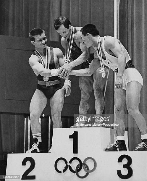 The winners of the Men's Bantamweight Weightlifting on the podium at Shibuya Public Hall Tokyo during the Olympic Games 11th October 1964 The winner...