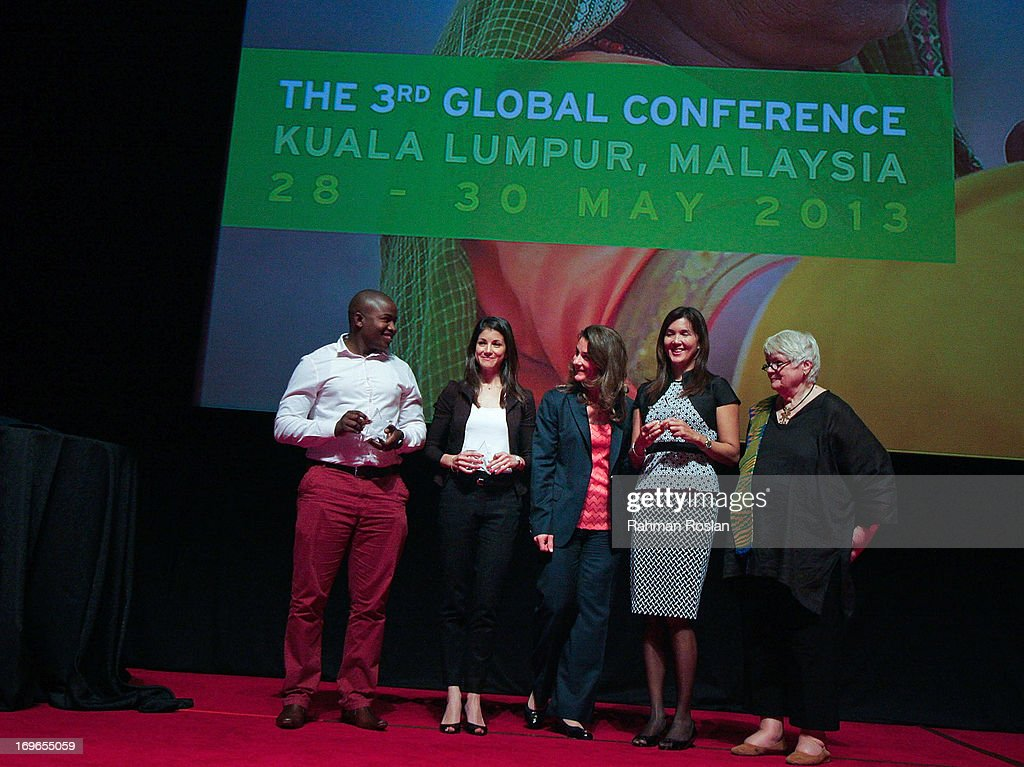The winners of The Women Deliver Rising Award, Remmy Shawam (far left), Imane Kachari (L) and Pia S.Cayetano (R) pose for a photograph with Co-Chair of Bill & Melinda Gates Foundation, Melinda Gates (C) and The President of Women Deliver Jill Sheffield (far R) during the third day of The Women Deliver Conference on May 30, 2013 in Kuala Lumpur, Malaysia. The WD conference brings together voices from around the world to call for action to improve the health and well-being of girls and women. The WD Conference builds on commitments, partnerships, and networks mobilized at the groundbreaking Women Deliver conferences in 2007 and 2010, fighting to end the deluge of preventable deaths that kill approximately 287,000 girls and women from pregnancy-related causes every year.