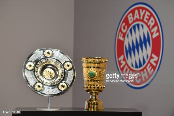 The winners trophy for the German Championship title and the DFB Cup are displayed prior to the Bundesliga match between FC Bayern Muenchen and...