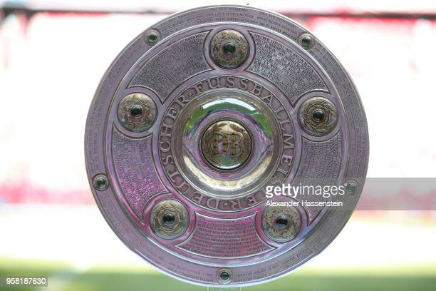 The winners trophy for the German Championship title is displayed prior to the Bundesliga match between FC Bayern Muenchen and VfB Stuttgart at...