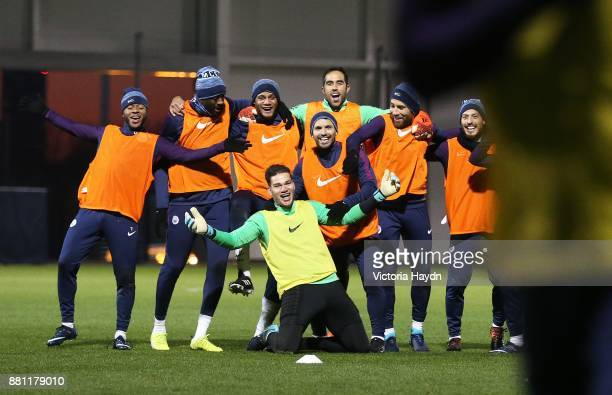 The winnig team of Raheem Sterling Yaya Toure Vincent Kompany Ederson Moraes Sergio Aguero Claudio Bravo Nicolas Otamendi and David Silva celebrate...