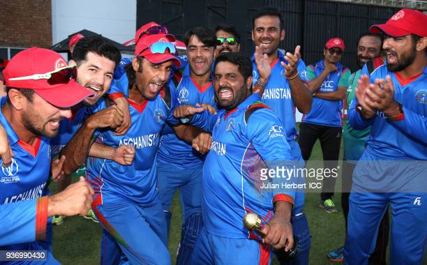 The winning Afghanistan team are led in celebrations by Mohammed Shahzad after The ICC Cricket World Cup Qualifier between Ireland and Afghanistan at...