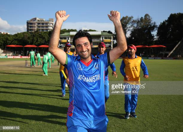 The winning Afghanistan team captain Mohamad Stanikazi leads his players off the field after The ICC Cricket World Cup Qualifier between Ireland and...