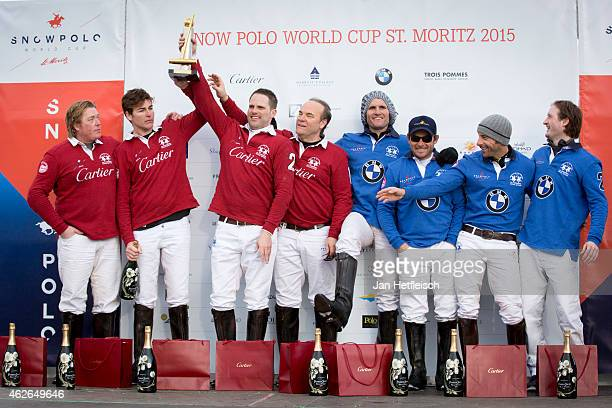 The winning 'Cartier' team and the 'BMW' team pose with the trophy on the final day of the Snow Polo World Cup 2015 on February 1 2015 in St Moritz...