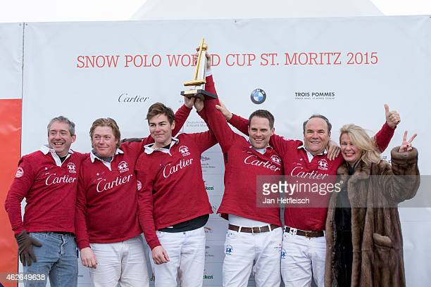 The winning 'Cartier' team poses with their trophy on the final day of the Snow Polo World Cup 2015 on February 1 2015 in St Moritz Switzerland